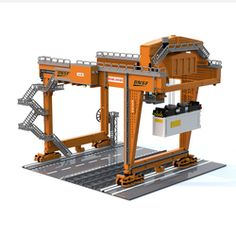 History The Rail Mounted Gantry (RMG) cranes are the result of decades of crane design experience and performance in the field. They incorporate both recent innovations and technologies proven in millions of on the job working hours to provide. Lego Crane, Small Ladder, Cable Reel, Crane Design, Gantry Crane, Plastic Model Cars, Lego For Kids, Lego Design, Bricolage