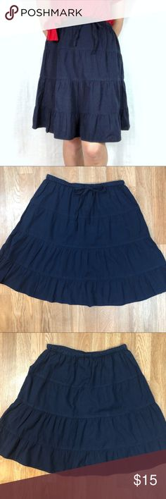 Never Worn Ruffled Knee Length Linen Skirt Navy skirt in a linen/cotton blend in an adorable shape!  Elastic waist with functional drawstring tie, a-line shape, ending in a wide, subtle ruffle.  Hem hits just above the knee.  Looks adorable with anything from sneakers to spring sandals!  Shown here with Side Tie Top also available in my closet.  Never worn!  Perfect condition! Bay Studio Skirts Midi