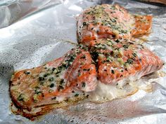Rosemary and Garlic Roasted Salmon    INGREDIENTS  2 6-oz. salmon fillets  1 tsp. extra virgin olive oil  1 tsp. fresh rosemary, chopped  1 large clove garlic, minced  salt and freshly ground black pepper    DIRECTIONS  1. Preheat oven to 425 F. Line a baking sheet with aluminum foil and lightly grease with cooking spray.    2. In a small bowl, combine the olive oil, rosemary, and garlic to form a paste.    3. Place salmon on the prepared baking sheet. Sprinkle with salt and pepper. Rub the…