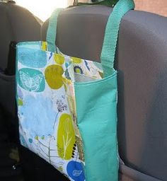 smart as car garbage or just extra storage for passengers/kids! resuable bag, velcro in the middle. simple! Easier than trying to see the other one I pinned!