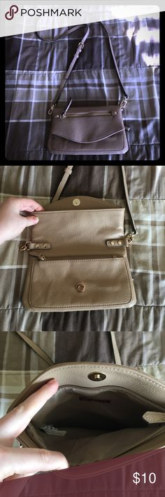 Merona Purse Tan Merona purse, in good condition with plenty of zipper pockets. The strap is 50in all the way around, adjustable and removable from both side of the purse. The bag is 6 1/2in deep and 9in wide. When opened, it's 10in deep. Slight scratches on the gold side loops, but barely noticeable. Merona Bags Crossbody Bags