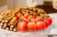 Perfectly designed Orange colored Peach shaped Wedding Cookies steal the show on a Dessert Plate at a William Penn Hotel wedding in Pittsburgh with the John Parker Band  http://www.jpband.com