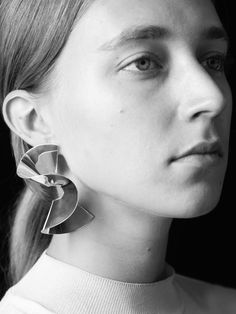 Wow. I am blown away by Swedish designer Sara Robertsson's absolutely stunning collection of sculptural silver jewelry. Earrings and ringsflow and fold, with controlled abandon, in one continuous sheet of sterling silver. Each piece is voluminous yet extremely lightweight in texture and modest in