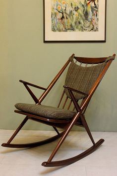 a beautiful rocker in fine grained wood this chair blends the bold style of the mid century with the handcrafted whimsical appeal of the classic rocking beautiful mid century modern danish style teak