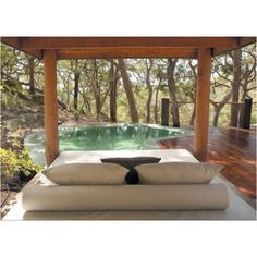 Outdoor swimming pool and a large bed by the side