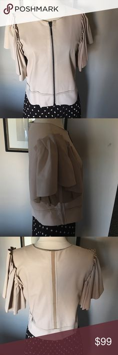 """HOTEL PARTICULIER MADE IN FRANCE CROP TOP NWOT,100%Lamb Leather,so lightweight and so soft ,you would think that it is clothe .Color is pinkish baby cream .Here is measurements ,I measured flat  .Shoulder  15,5"""" ,Bust 18,5"""" , Bottom 18,5"""" ,Length from shoulder to hem 19,5"""" Hotel Particulier Tops"""