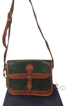 Dooney & Bourke Mint! Rare Vintage All Weather Leather Tote Crossbody Handbag Shoulder Bag. Get one of the hottest styles of the season! The Dooney & Bourke Mint! Rare Vintage All Weather Leather Tote Crossbody Handbag Shoulder Bag is a top 10 member favorite on Tradesy. Save on yours before they're sold out! ON SALE TODAY!!!