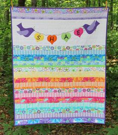 Baby jelly roll strip quilt.