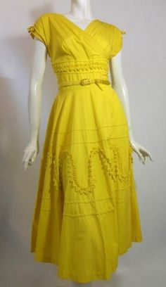 1950's dress of bright yellow cotton with ruffled appliques.