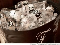 tub with personalized wedding water bottles