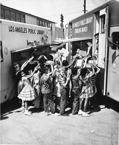 Children clamor for books from the @LApubliclibrary bookmobile #onthisday in 1960