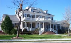 Eplans House Plan: This home provides a breathtaking example of the Neoclassical tradition. An impressive entrance is formed by an arched porch, fanned stairway, and columns. Upper and lower balconies, shuttered Palladian win