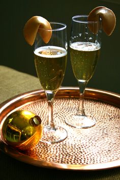 put a fortune cookie on each glass of champagne, sweet idea for New Year's Eve