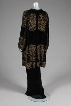 Mariano Fortuny stencilled velvet jacket, circa 1920-30, large circular label to the lining, adorned with delicate fern-like traceries in gold, lined in pale, golden satin, edged in black braid with ties to the neck