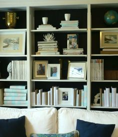 How to Style a Bookcase by Laurel Bern | Westchester County Interiors | http://westhamptondiy.blogspot.com/2011/08/family-room-makeover-part-3-decorating.html
