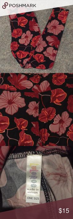 LuLaRoe NWOT OS Floral Leggings LuLaRoe NWOT OS (One Size) leggings with flowers in shades of a dusty rose/ballet pink and two shades of red with orange detailing on a black background. The colors are more muted and deep as posed to bright, though the pictures are more accurate on this listing than on my previous listing for these. The third picture is perhaps the most accurate. Smoke free home. LuLaRoe Pants Leggings