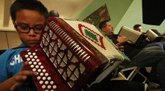 Newsela   Music school squeezes in students for squeeze-box lessons