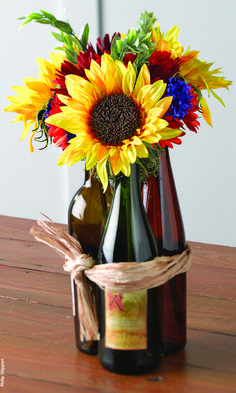 Image result for sunflower centerpieces in cut wine bottles
