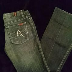 7 for all mankind long Really great 7 for all mankind in a medium rinse with subtle distressed accents. In great condition. Minimal wear at hems.  34 inch inseam Front measures 16 inches Back measures 15&3/4 with a 2 inch drop Largest part of pants at bottom measure 10 inches 7 for all Mankind Jeans Boot Cut