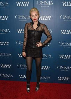 Miley Cyrus Leather Dress - Miley Cyrus rocked a little black leather dress with a sheer yoke and sleeves while attending an Omnia Nightclub event.