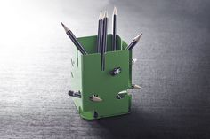 "Pencil holder ""Delicious monster"" by Holly Birkby for Carrol Boyes. With nooks and holes for pencil stubs."