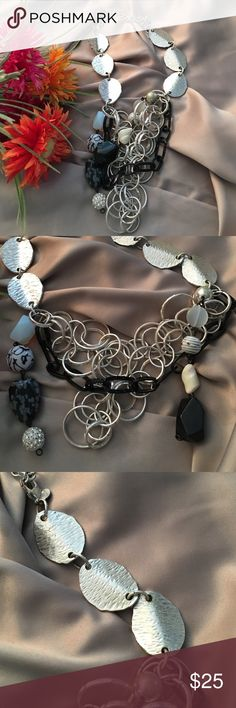 Chico's necklace Unusual Chico's necklace in silver, black & white.  Very difficult to explain.  I took close up pics but if you have any questions please ask!Purchased to wear w/black suit.  Worn once. Chico's Jewelry Necklaces