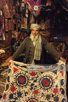 An Afghan shopowner selling Afghan carpets and rugs seen in his shop in Chicken Street on October 17, 2011 in Kabul, Afghanistan. Chicken Street has been a focus for Afghanistan's tourists since the days of the Hippy Trail. All kinds of handicrafts are available here, from jewellery to carpets, 'antique' muskets to poached furs.