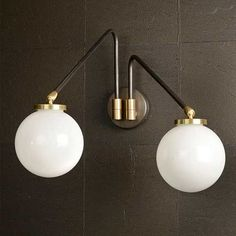 Please contact us for a quote.     Fabulous twin armed wall light in bronze with satin brass mount. Black painted arms and opal glass sphere shades by CTO Lighting.