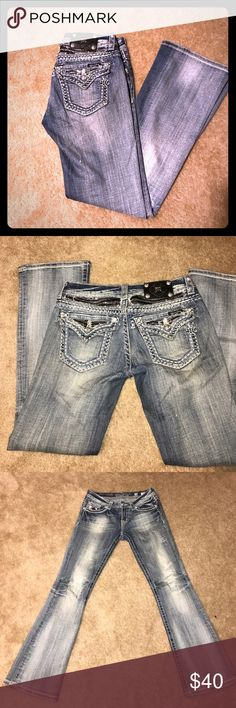 Miss Me Jeans sz 28 distressed boootcut Miss Me Jeans sz 28 distressed denim. Great used condition with all bling intact. Smoke free home. Offers welcomed. Thanks. Miss Me Jeans Boot Cut