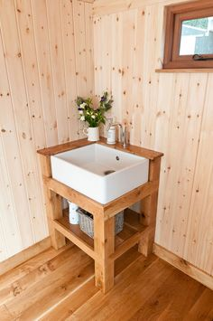 Sink in a shepherd hut with oak paneling...I could camp like this:-)