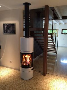 This Scan 83 in white is what we consider a master piece! http://jotul.com/uk/products/wood-stoves/Jotul-F-373