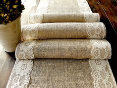 """This beautiful rustic wedding table runner is made with 100% natural golden brown burlap and the edges are trimmed with country cream vintage inspired lace. Just a touch of natural country elegance. This lace goes with all laces ...  Runners are 74""""inches long by 12 inches wide   All my runners edges are surged on the edges and will not fray, they will lay flat and beautiful on your tables."""