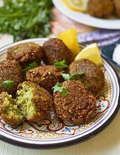Homemade Lebanese Falafel Recipe with Tahini Yogurt Learn how to make homemade Lebanese falafel recipe with dried chickpeas, loads of fresh herbs and warm spices. Serve with creamy tahini yogurt. Lebanese Falafel Recipe, Lebanese Recipes, Jewish Recipes, Vegetarian Recipes Dinner, Vegan Recipes, Vegan Vegetarian, Dinner Recipes, Kosher Recipes, Cooking Recipes
