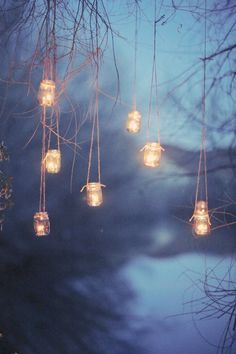 Woodland Fairy Magic, mason jar lights hung from trees
