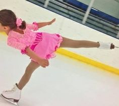 Sk8 Gr8 Designs.Custom Competition Figure Skating Dress. This Mary Poppins ice skating dress uses pinks and cerise to replace the standard white and red, to insure the skater stands out on the white ice. www.sk8gr8designs.com