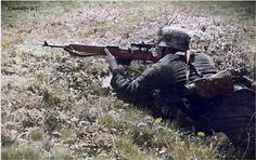 German sniper with a gewehr 43 rifle.