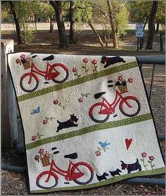 Stowaways Quilt with Bikes and Scottie dogs. ... Uh oh! It looks like the puppies are getting away. Luckily this mama dog is fast. You can needle turn the applique for this quilt, or make it simple and use fusible webbing. Any way you go the finished product is darling!.... #quilt ...... #quilting
