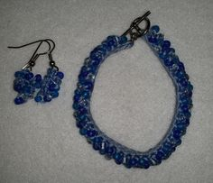 Crocheted Bead Bracelet Kit  The kit includes blue, purple, and clear 6/0 Czech glass beads, DMC embroidery floss, beading needle, a crochet hook, silver-tone toggle clasp and earring fish hooks.  http://meandercanyoncrafts.blogspot.com