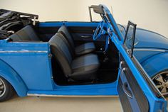For sale by Autobarn Classic Cars in Concord, North Carolina, a 1966 Beetle Ford Grabber Blue Convertible, lovingly restored and customized by the local owner in full rotisserie fashion. Price: $27,995.00 USD