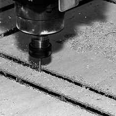 Cutting panels with CNC robots