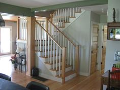 Google Image Result for http://www.treehousewoodworking.com/Images/custom_stairway_flat_panel_fir_column_painted_ceiling_beam.jpg