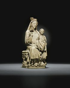 MOSAN OR NORTH FRENCH, CIRCA 1250-1260 VIRGIN AND CHILD ENTHRONED ivory, with traces of gilding and polychromy 23.7cm., 9 3/8 in.