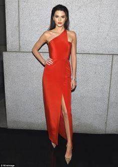 Fierce! The daughter of Bruce Jenner let her toned leg peek through the slit...