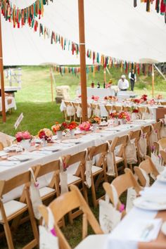 love the hand made bunting, casual set up, and the canvas tote wedding favors on the chairs