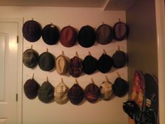 diy hat rack. using hercules hooks, cotton twisted line and wood clothespins.