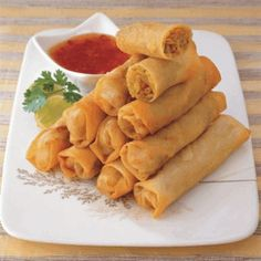 Recipe - Vegetable Spring Rolls - Heat vegetable oil in a large pan, add and cook ginger and garlic until fragrant then add onion and stir over medium heat for 2 minutes.Add celery, carrot, zucchini, green bell pepper and cabbage. Stir for few minutes or until vegetables are almost tender then add MAGGI Vegetable Stock cubes, white pepper and sesame oil. Stir to combine well. Remove from heat and place the mixture on a plate until it cools into a room temperature.