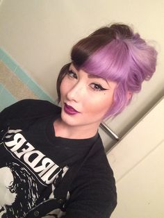 Contrast hair, half brown, half lavender purple.