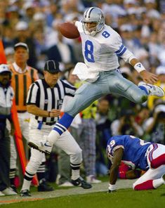 77ab4393e Troy Aikman hurdles a Buffalo Bills defender on a scramble. The Dallas  Cowboys quarterback was