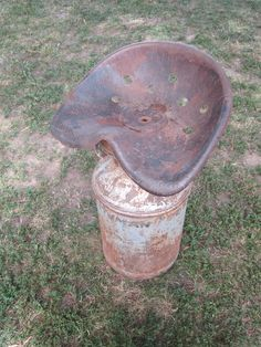 Vintage Tractor Seat Welded to a Milk Can, creates chair or bar stool. For ideas and goods shop at Estate ReSale & ReDesign, Bonita Springs, FL. Upcycle, recycle, repurpose, diy, salvage!