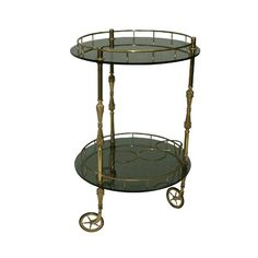 Round Brass Bar Cart: Mid Century Modern round bar cart with smoky grey glass. great accent piece for any bar or cigar lounge Sundrop Vintage Rentals/ Rent Vintage Furniture in California for Weddings/ Parties/ Events/ Photo shoot/ Bridal Shower/ Sofa /Settee/ Vintage/ Boho/ Baby Shower/ Rentals